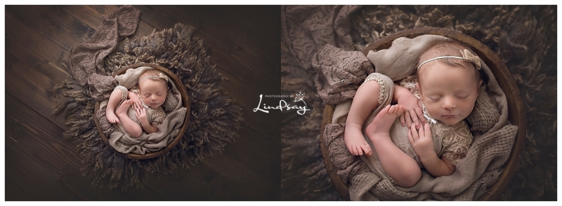 Baby girl asleep in wooden bowl while wearing brown lace outift at Photography by Lindsay studio.