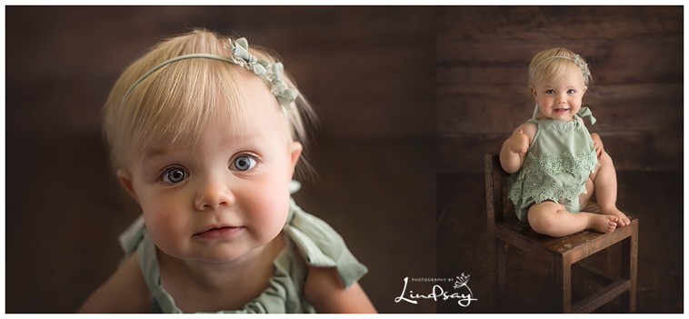 12 month old looking at the camera and sitting in a wooden chair at Photography by Lindsay studio.