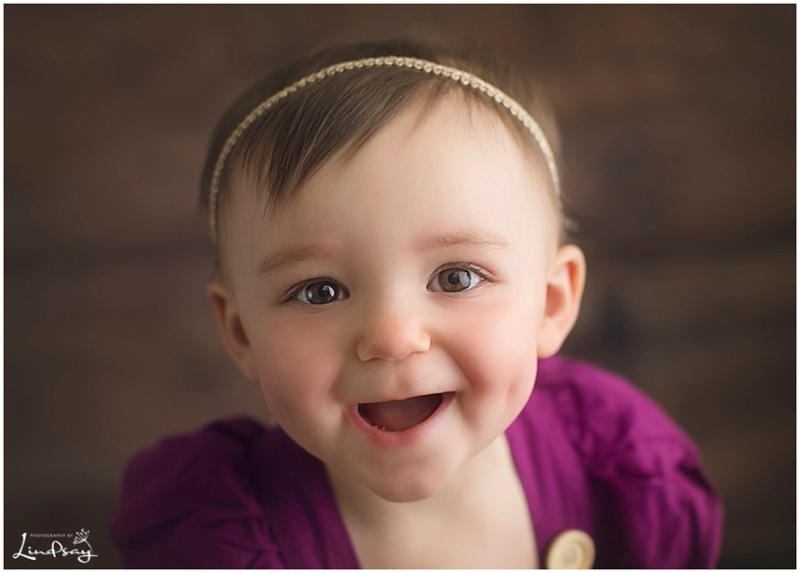 Close up of one year old girl at Photography by Lindsay Martinsburg studio.