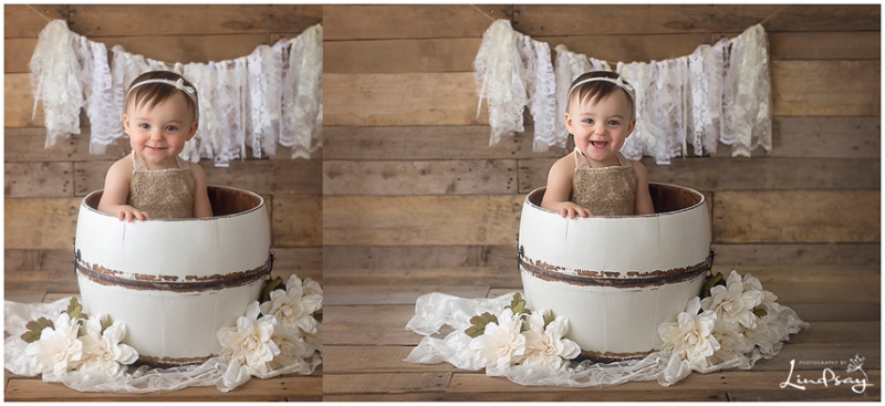 Baby girl in white prop while wearing cream romper at Photography by Lindsay studio.