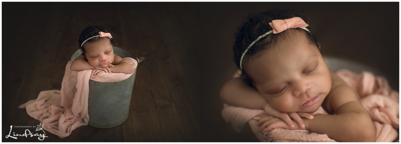 Baby girl asleep in tin bucket with pink wrap at Photography by Lindsay Martinsburg studio.