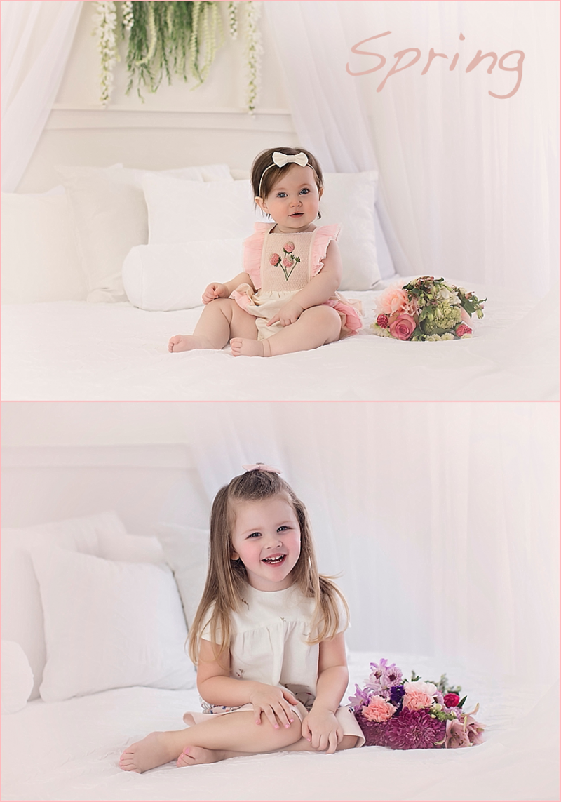 Two girls on white bed with flowers posing for spring photo session.
