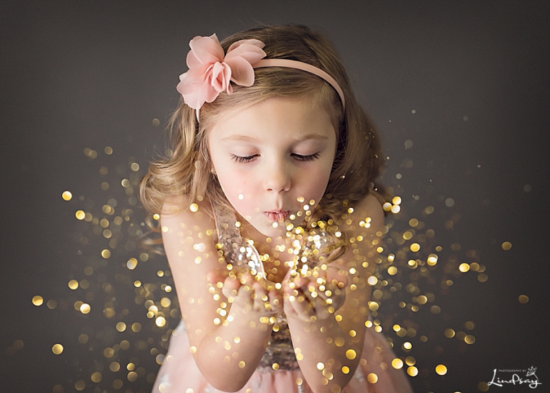 Glitter photo shoot with 5 year old girl at Photography by Lindsay studio.