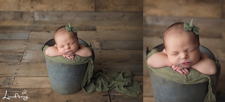 Cute baby girl photos of newborn in a bucket and asleep while at photography by Lindsay studio.