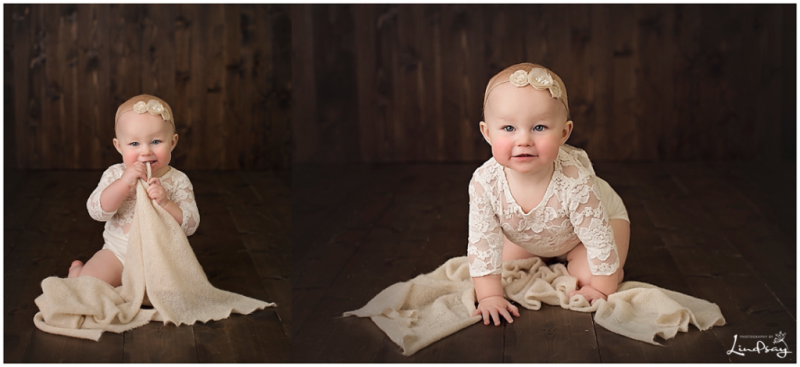 Two images of baby girl wearing cream lace romper and sitting on wood backdrop while smiling at camera.