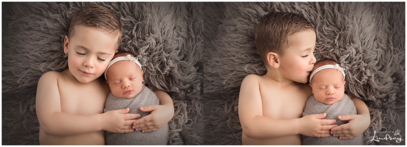 Two images of big brother with his baby sister while laying on grey rug while at Photography by Lindsay studio.
