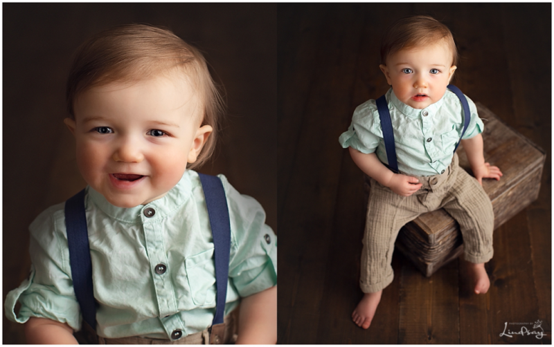 Two images of baby boy wearing suspenders and sitting on wooden box while at Photography by Lindsay studio.