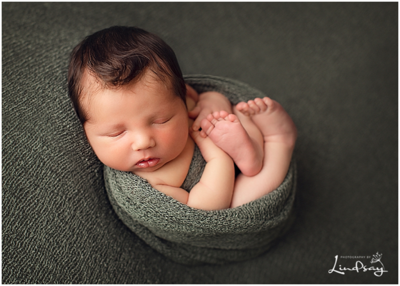 Baby boy swaddled in green fabric and sleep taken by local newborn photographer, Photography by Lindsay.